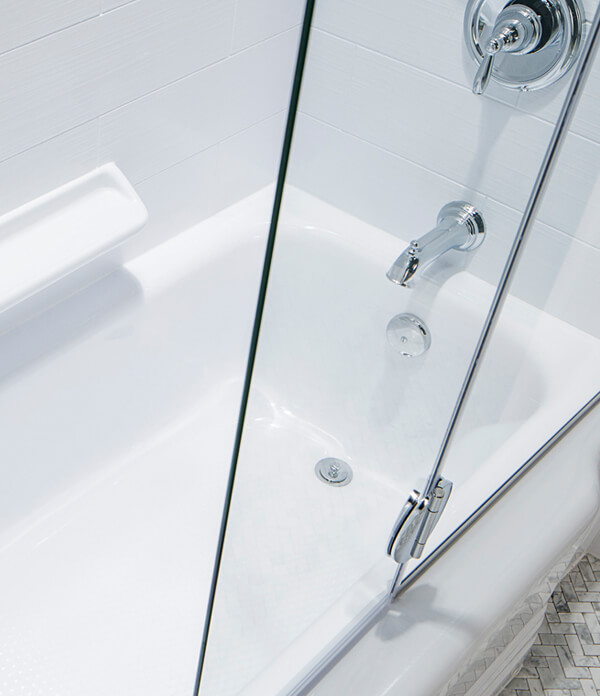 empire bathtub with sliding glass door and chrome faucet