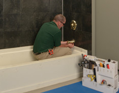 Bath Fitter installer removing faucet system